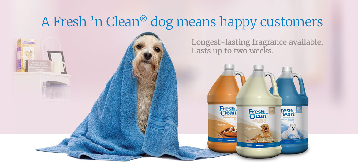 Bathed dog in a towel, featured products Fresh 'n Clean® gallon formulas for groomers.